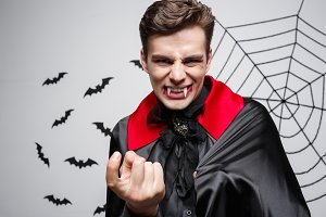 Vampire Halloween Concept - Portrait of Angry caucasian vampire screaming.