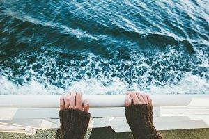 Traveler hands above sea view