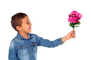 Adorable boy offering flowers