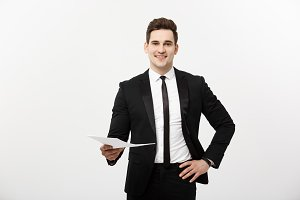 Business and Job Concept: Elegant man in the suit holding resume for job hiring in the bright white interior.