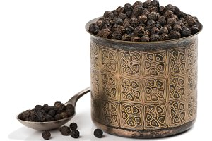 Dried black peppercorns.