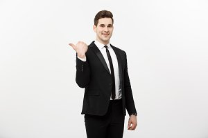 Handsome young business man happy smile point finger to empty copy space, businessman showing pointing side, concept of advertisement product, isolated over white background.
