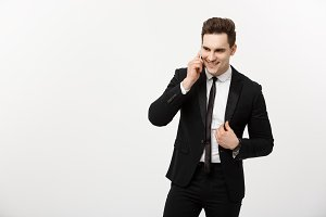 Business Concept: Portrait of a cheerful businessman in smart suit talking on the smart phone isolated on a white background