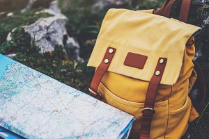 Traveler's map and backpack