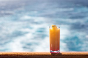 Glass of tequila sunrise on cruise ship