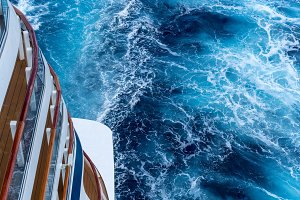 View down at the aft of cruise ship with churning ocean
