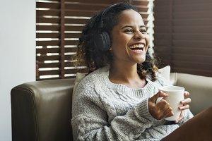 Woman enjoying music on her sofa