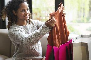 Woman unpacking a shopping bag