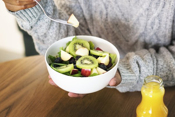 Woman holding a bowl of healthy