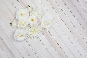 White Flowers on White Wood Table