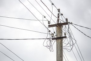 Electric pole on a gray sky