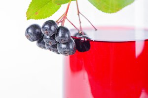 Glass of aronia juice with berries