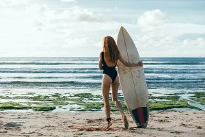 Young surfing girl