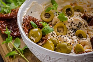 Fresh cheese with olives, dried tomatoes