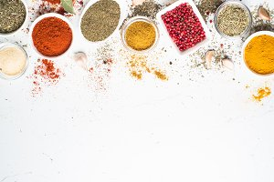 Various spices in a bowls on white.