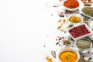 Spices in a bowls on white.