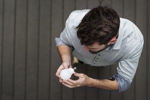 A man changing a light bulb