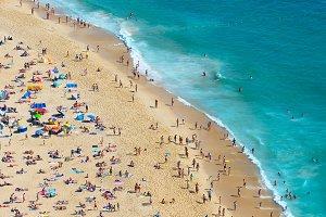 Crowd people ocean beach Portugal