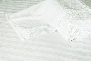 white towel on white mattress