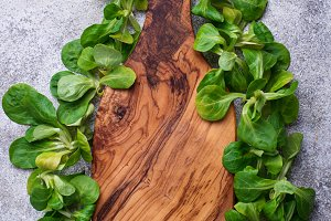 Corn lettuce and cutting board