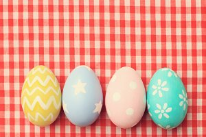 Colorful easter eggs on tablecloth