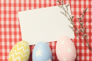 Colorful easter eggs and blank note