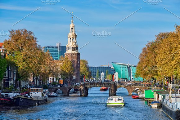 Amterdam canal, bridge and medieval houses in Graphics