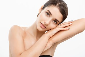 Beauty Youth Skin Care Concept - Close up Beautiful Caucasian Woman Face Portrait with relax sleep gesture. Beautiful Spa model Girl with Perfect Fresh Clean Skin over white background