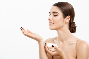 Beauty Youth Skin Care Concept - Beautiful Caucasian Woman Face Portrait smiling and holding cream jar for body and skin.Isolated over white background.