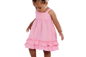 Happy african baby with pink dress