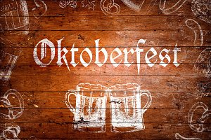 Oktoberfest sign, beer mugs, chalk drawings, wooden background