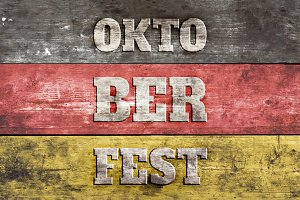 Oktoberfest sign, German flag on old wood plank background.