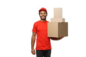 Delivery Concept - Portrait of Happy African American delivery man in red cloth holding a box package. Isolated on white studio Background. Copy Space
