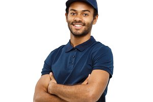 Delivery Concept - Handsome African American delivery man crossed arms over isolated on white studio Background. Copy Space