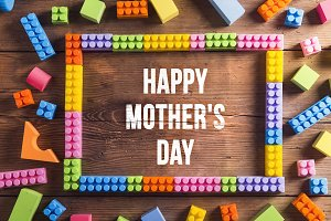 Happy Mothers Day sign. Frame composition. Wooden background. St