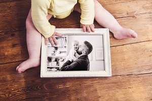 Fathers day composition. Picture frame. Wooden background.