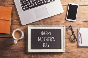 Happy mothers day sign. Studio shot, wooden background.