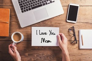 I love you mom sign. Studio shot, wooden background.