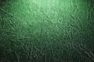 Piece of old rumpled green paper as background