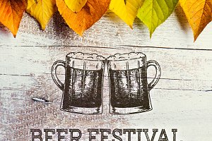 Beer festival sign with beer mugs and colorful leaves