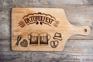 Oktoberfest sign with various hand drawn symbols, cutting board