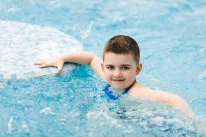 Boy in swimming goggles relaxing jac