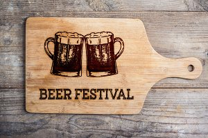 Beer festival sign with two beer mugs, cutting board