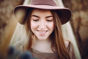 Close-up portrait of cheerful girl in a hat. Artwork.