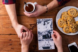 Mans and womans hands. Black-and-white photo. Couple. Tea and co