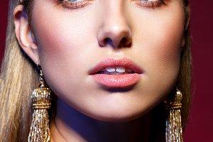 beautiful girl with long earrings