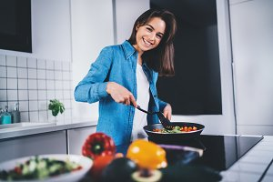 Happy smiling woman cooking