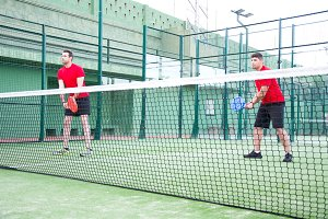 friends playing paddle tennis