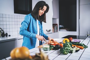 Beautiful woman preparing vegan food