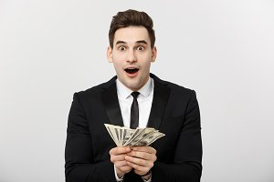 Business Concept: Portrait of shocked businessman showing a lot of money isolated over white background.